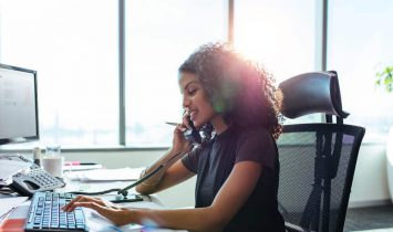 Female office worker on telephone using direct routing vs calling plans